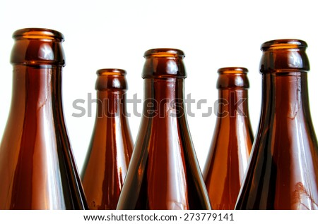 Empty glass bottles for industrial disposal. #273779141