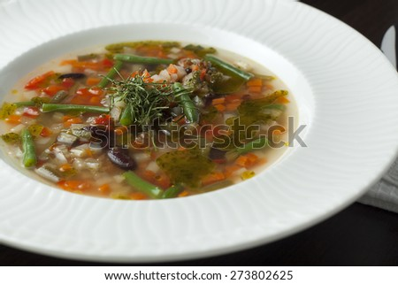 Vegetarian minestrone soup on a wooden table. Italian cuisine. #273802625