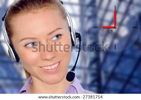 Woman wearing headset in office; could be receptionist on business architecture background #27381754