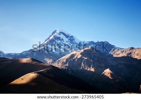 Autumn view of Kazbek (Kazbegi) mountain in Georgia, just before sunset #273965405