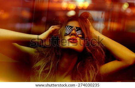 dark color toned picture of fashionable woman in nightclub