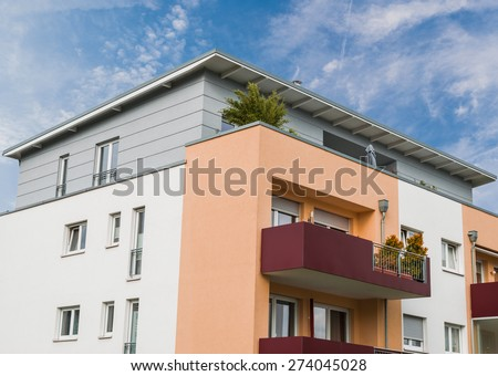 modern house facade in Essen Germany and blue sky #274045028