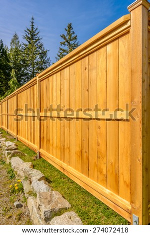 wooden fence with green lawn and houses #274072418