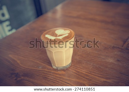 coffee latte cup on a wood table -vintage effect style pictures #274110851