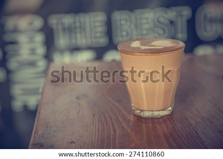 coffee latte cup on a wood table -vintage effect style pictures #274110860