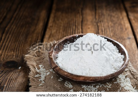 Heap of Rice Flour(close-up shot) on wooden background #274182188