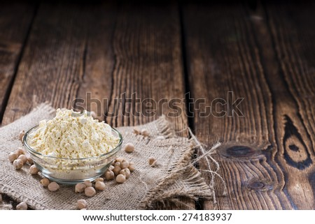 Heap of Chick Pea flour on an old wooden table #274183937
