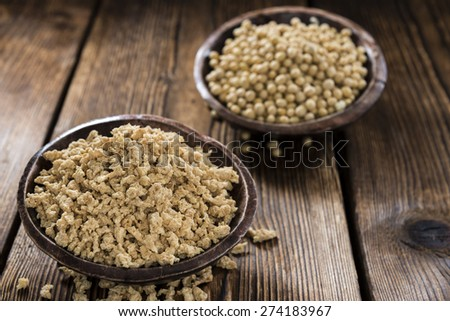 Portion of dried Soy Meat (close-up shot) on wooden background #274183967