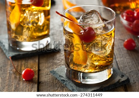 Homemade Old Fashioned Cocktail with Cherries and Orange Peel Royalty-Free Stock Photo #274311449