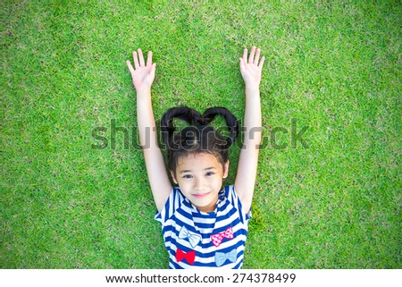 Living with natural clean environment, and ecological friendly concept with Asian kId lifestyle having fun on green lawn  #274378499