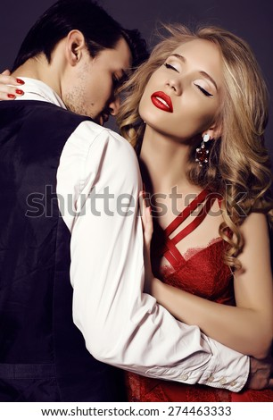 fashion studio photo of beautiful sensual couple in elegant clothes  #274463333