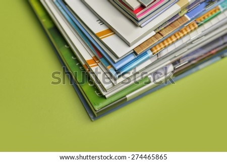Colorful abstract background image of stacked magazines. Royalty-Free Stock Photo #274465865