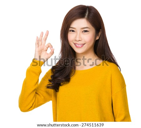 Young woman with ok gesture #274511639