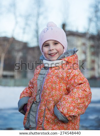 Portrait of little girl in winter clothes #274548440