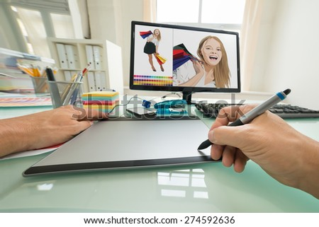 Close-up Of A Person Using Graphic Tablet For Sketching. Photographer owns copyright for images on screen #274592636