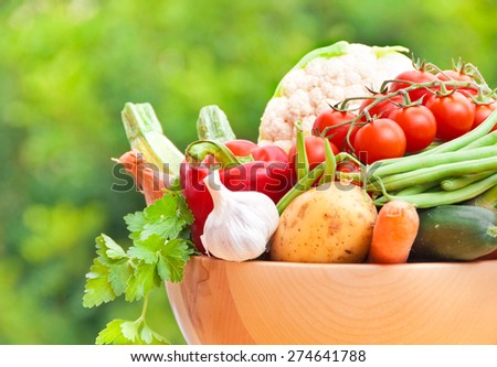 Mixed fresh vegetables in a wooden bowl  #274641788