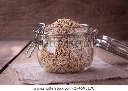 uncooked quinoa in the glass jar on rustic wooden background. toning #274695170