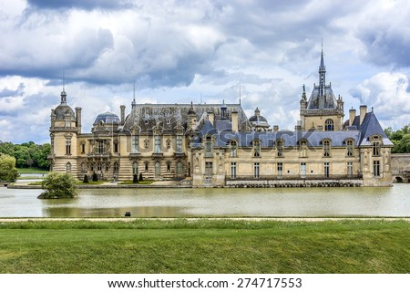 Famous Chateau de Chantilly (Chantilly Castle, 1560), is a historic chateau located in town of Chantilly, Oise, Picardie, France. #274717553