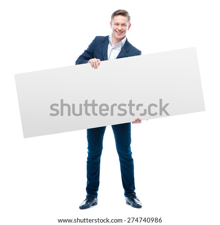 Your advertisement in good hands. Handsome young business man holding big blank with copy space. Isolated on white. #274740986