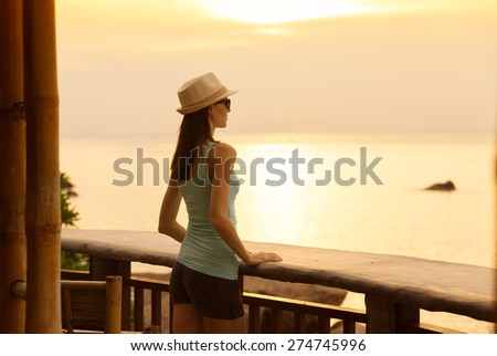 Woman watching the sunrise.  #274745996