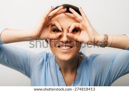 Pretty brunette girl shows glasses hands #274818413