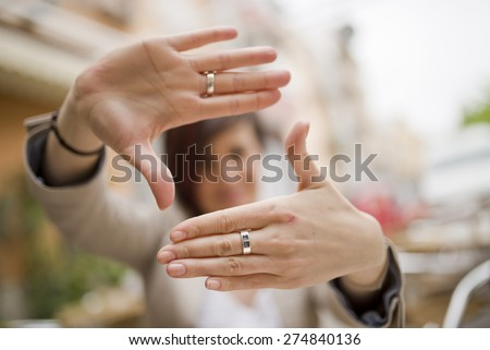 Out of focus woman and framing symbol in natural light outdoors image