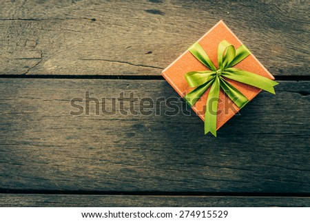 Christmas Gift box on wooden background - Vintage effect style pictures