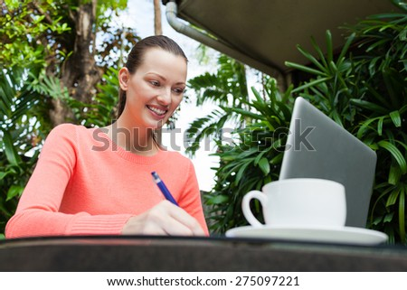 Happy woman taking notes. #275097221