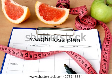 Paper with weight loss plan and grapefruit #275148884