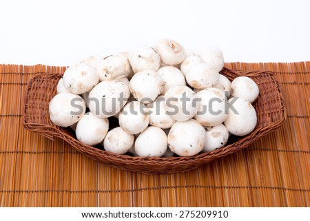 white mushrooms in a basket  #275209910