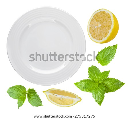 Top view of isolated white plate with lemon and mint #275317295