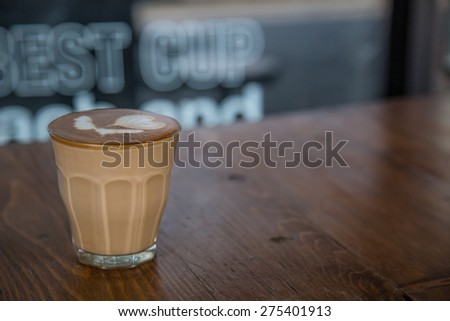 coffe latte cup on a wood table #275401913