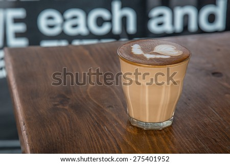 coffe latte cup on a wood table #275401952