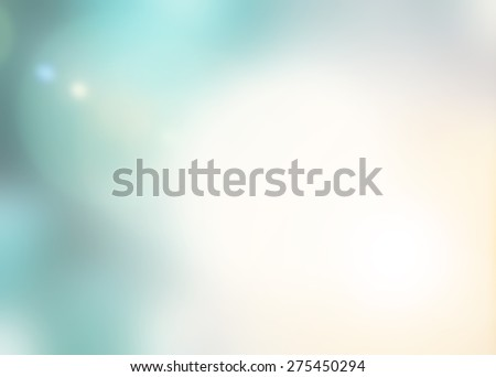 Blur background with nature glowing sun light flare and bokeh in cyan turquoise and warm yellow color