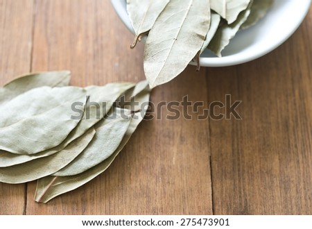 bay leaves on a wooden table #275473901