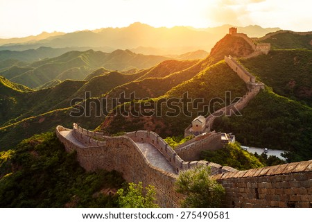 Great wall under sunshine during sunset Royalty-Free Stock Photo #275490581