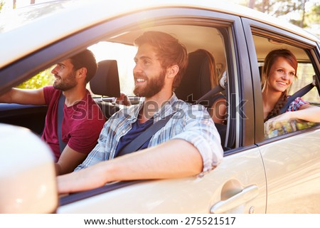 Group Of Friends In Car On Road Trip Together #275521517