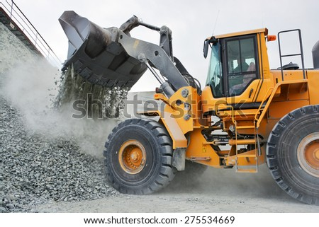 big yellow mining truck in quarry Royalty-Free Stock Photo #275534669