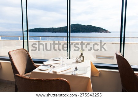 Romantic table setting by the seaside #275543255