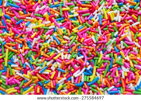 Sugar sprinkle dots, decoration for cake and bekery, a lot of sprinkles as a background Royalty-Free Stock Photo #275584697