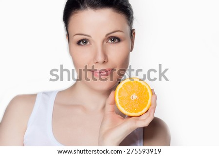 Beautiful close-up portrait of young woman with oranges. Healthy food concept. Skin care and beauty. Vitamins and minerals. #275593919