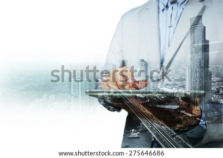 Double exposure of city and businessman on the phone as Business development concept. Royalty-Free Stock Photo #275646686
