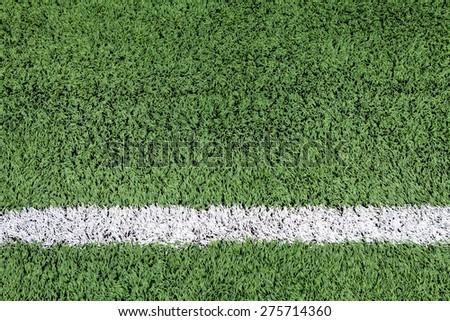 White stripe on the green football field #275714360