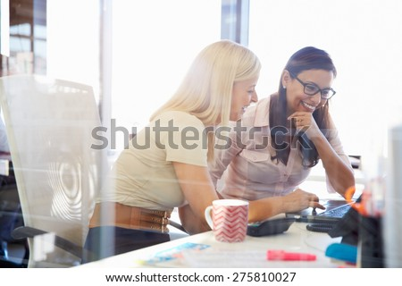 Women working together, office interior Royalty-Free Stock Photo #275810027