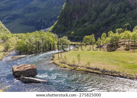 The mountain river in Flam valley in the mountains of Norway #275825000