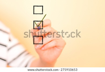 Hand putting check mark with pen #275910653
