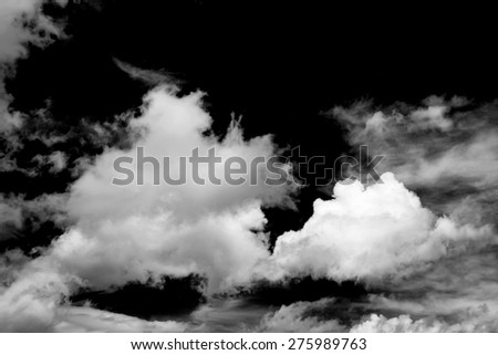 Black and White fluffy clouds in the blue sky