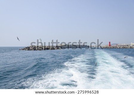 seawall with lighthouses in the Moseulpo in Jeju Island, Korea. #275996528