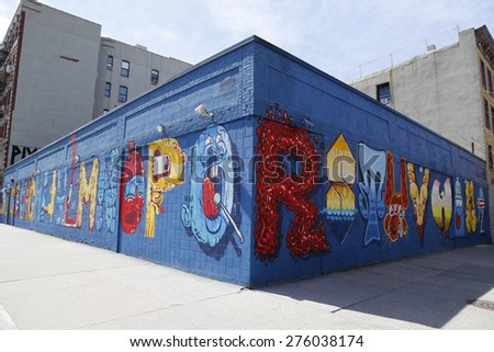 NEW YORK - APRIL 16, 2015: Mural art at Alphabet City in East Village, Lower Manhattan. A mural is any piece of artwork painted or applied directly on a wall, ceiling or other large permanent surface #276038174