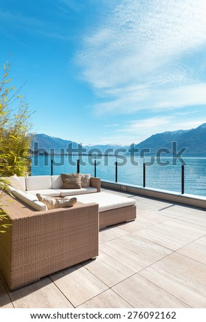 modern architecture, beautiful lake view from the terrace of a penthouse #276092162
